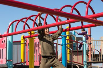Displaced Yazidi children enjoy the playground at the Northern Iraq Community Center.