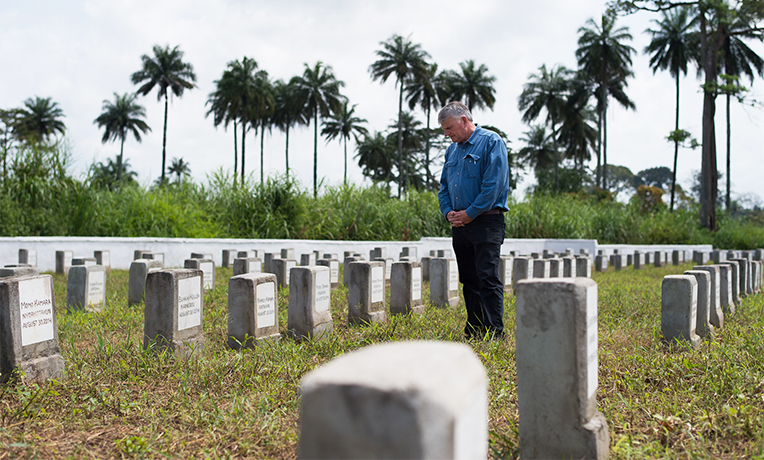 Franklin Graham pauses to pray at Ebola Memorial Cemetery in Foya, Liberia.