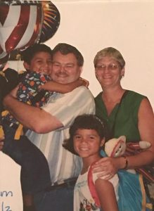 Jaki with her family as a young girl