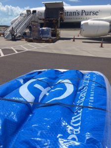 Shelter kits are unloaded from Samaritan's Purse DC-8 aircraft