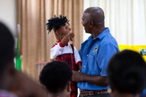NEVILLE REMKISSOON DEMONSTRATES WITH A PUPPET HOW TEACHERS CAN ENGAGE CHILDREN WITH THE GOSPEL MESSAGE.