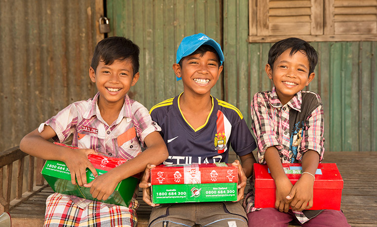 3 boys enjoying their shoeboxes