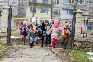 Children running with shoebox gifts