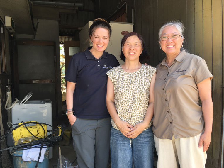 Some of the Samaritan's Purse team stand with homeowner Rumiko Hironishi (centre). Volunteers from the Christ Church Kure volunteer centre helped clean up a room on her first floor.