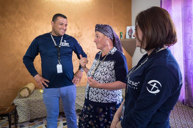 The Samaritan's Purse team encourages Anka (centre) during their visits.