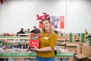 Volunteer with Shoebox gift