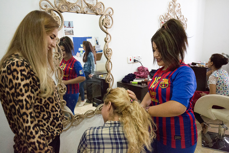 Angel (right) learns the how to become a beautician from her instructor Marwa (left).