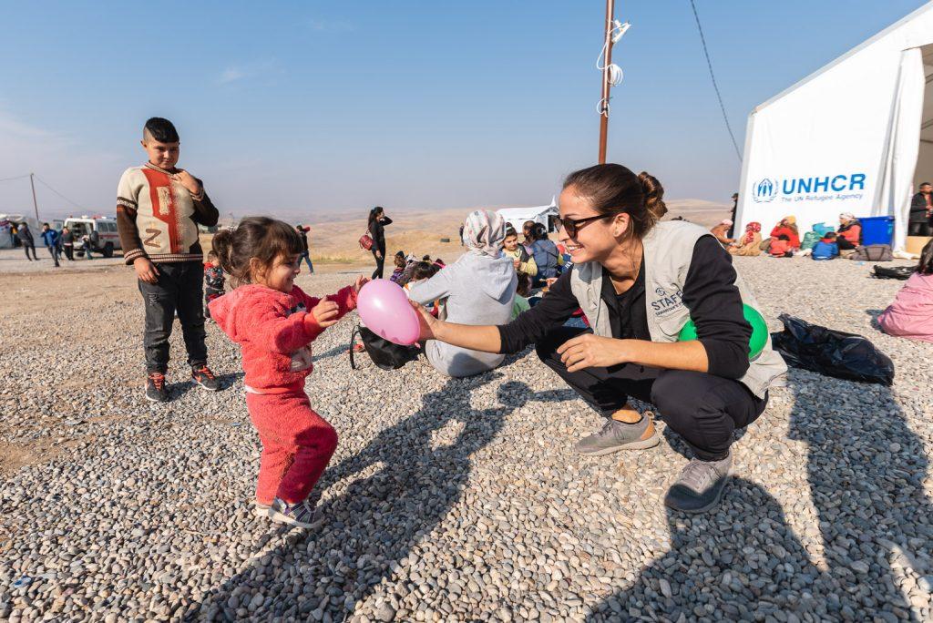 Samaritan's Purse staff member Jessica Lutz brightened a child's day with a balloon.