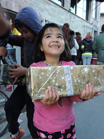 Girl beams with shoebox gift