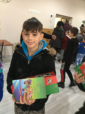 Boy with shoebox gift and TGG