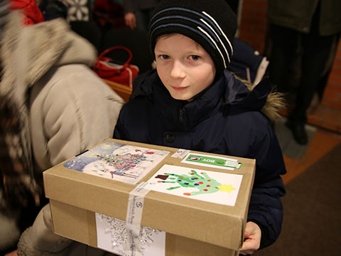 Boy with hand decorated shoebox gift