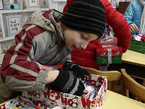 Boy explores shoebox gift