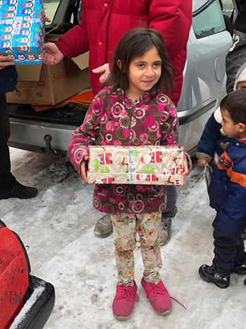 Girl with shoebox in snow