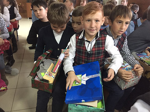 Boy with blue shoebox