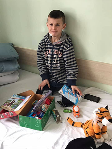 Boy in hospital with shoebox gift