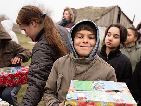 Boy smiles with shoebox