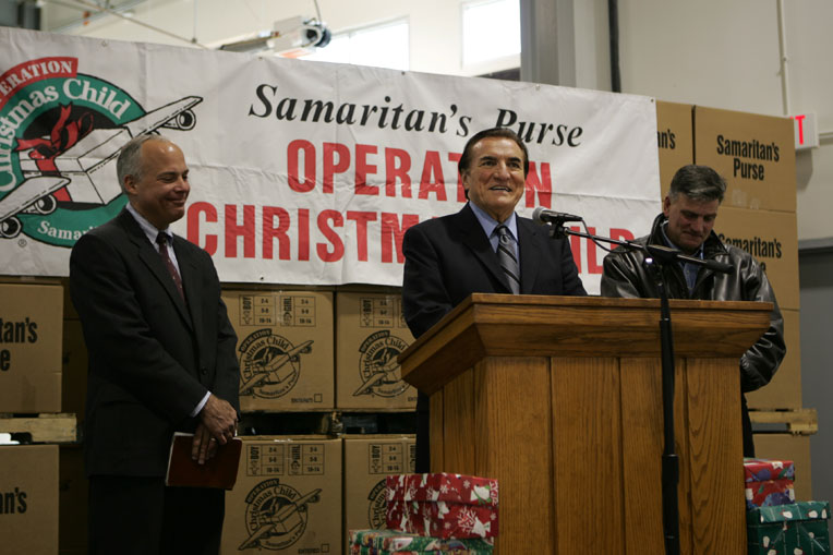 The late Ross Rhoads, center, Samaritan's President Franklin Graham, and Operation Christmas Child Vice President Jim Harrelson celebrate the delivery of shoebox gifts around the world.