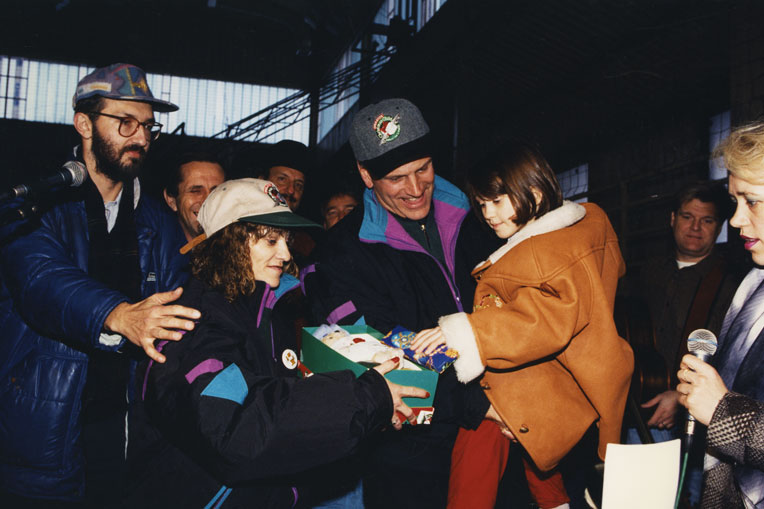 Franklin Graham delivers shoeboxes with Mary Damron in Eastern Europe.