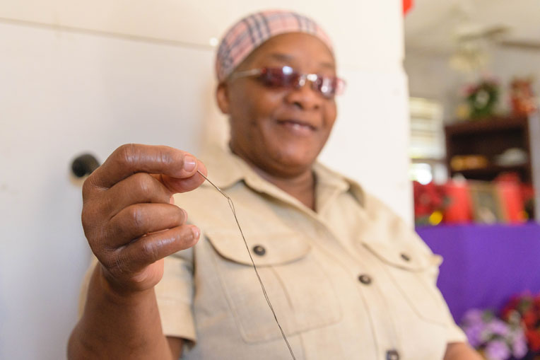 Carmel Brown can still thread a needle even though she is blind.