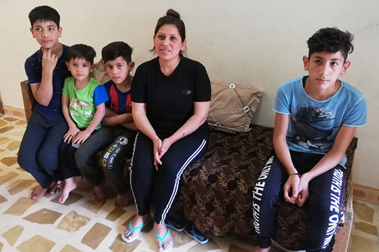 Enas and her children were grateful to receive relief supplies from Samaritan's Purse.