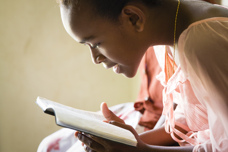 This participant in The Greatest Journey discipleship program in Fiji pores over the Bible she received at graduation.
