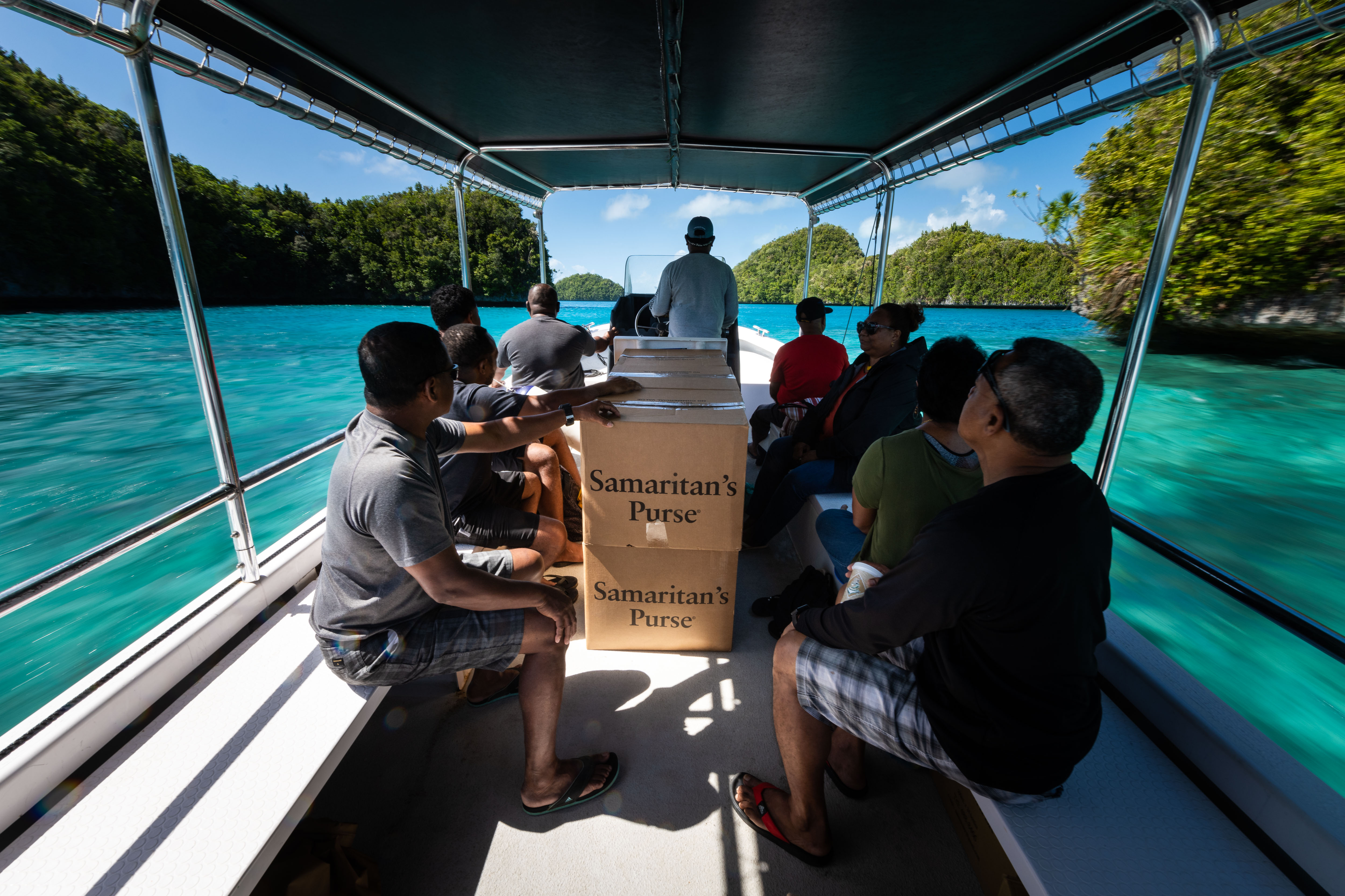 SHOEBOX GIFTS TRAVEL BY CHARTERED BOAT FROM KOROR THROUGH THE ROCK ISLANDS TO PELELIU FOR THE FIRST OUTREACH EVENT IN PALAU.