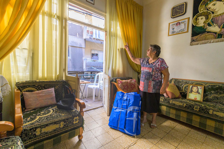Malak* plans to use her tarp from Samaritan's Purse to temporarily replace her door that blew off in the blast.