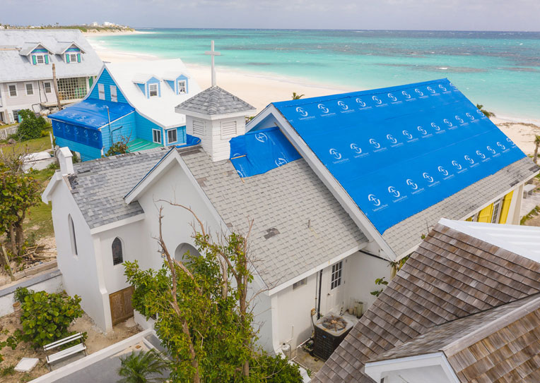 Volunteers tarped the roof of this church in the Bahamas after Hurricane Dorian