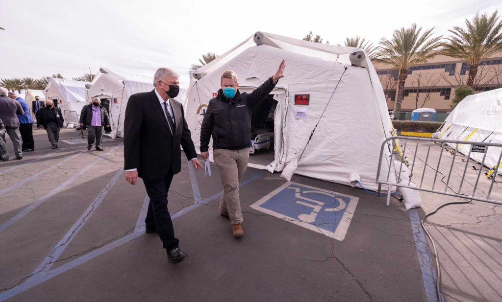 Franklin Graham toured the Emergency Field Hospital in Los Angeles County alongside Dr. Elliott Tenpenny, director of the Samaritan's Purse International Health Unit